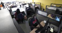 Image of Lighthouse Works contact center agents working at their desks taking calls