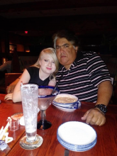 an image of Jessenia and her father sitting at a dinner table