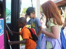 Three Lighthouse Academy Students getting on a LYNX bus together
