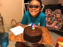 School-Age student, Basil B., seen here celebrating his 8th birthday with a chocolate cake