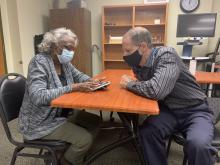 Dorothy receiving Assistive Technology Training on her iPhone by Lighthouse instructor Chris Sacca