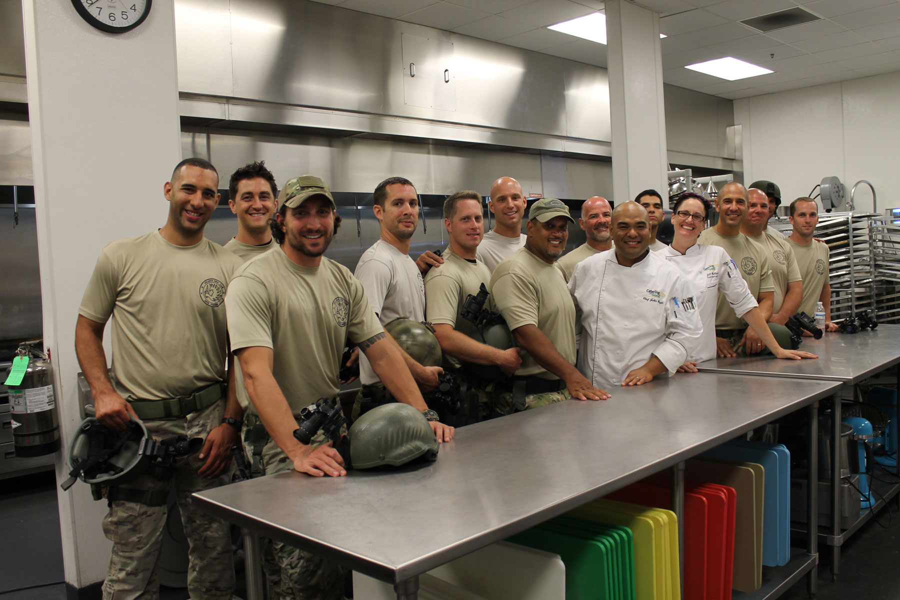 the Orlando Police Department SWAT team lined up in the kitchen with the chef's at the Dining in the Dark event