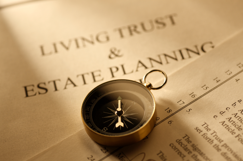 A stack of documents with a header that says Living Trust and Estate Planning